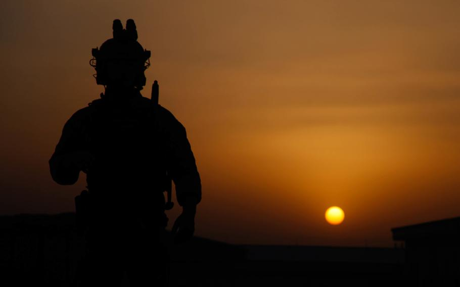 A U.S. Special Forces soldier waits for nightfall to start an operation in Laghman province, Afghanistan, in 2016.