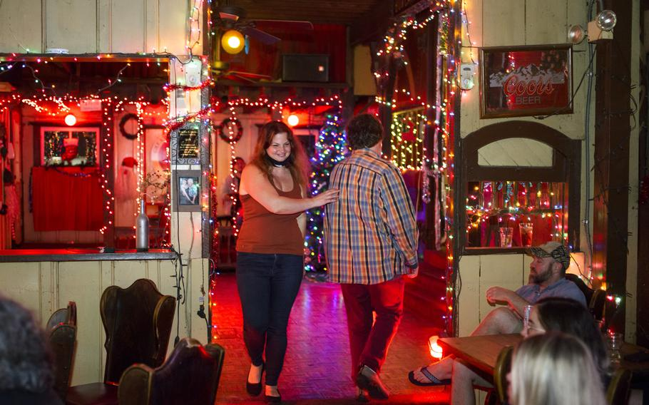 Bartender Michelle Beebe, left, says hi to a customer at Donn's Depot, a piano bar in Austin, on June 3, 2021.