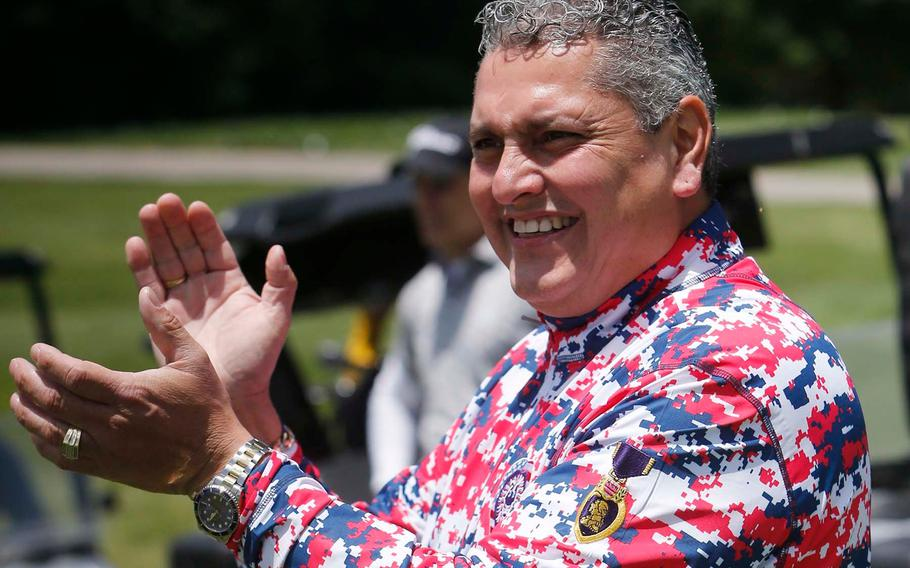 Major Ed Pulido, the founder and CEO of the John Daly-Major Ed Heart of a Lion Foundation, applauds golfers as they tee off on 17 on the North Course at Firestone Country Club Tuesday, June 22, 2021 in Akron, Ohio.