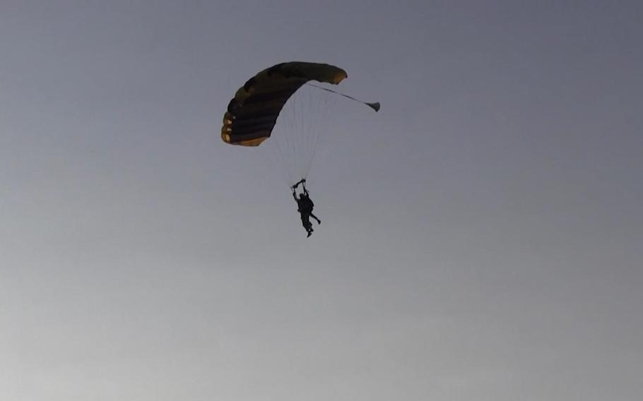 Retired Green Beret and jumpmaster Bob Schneider skydives on July 31, 2021, to celebrate his 90th birthday.