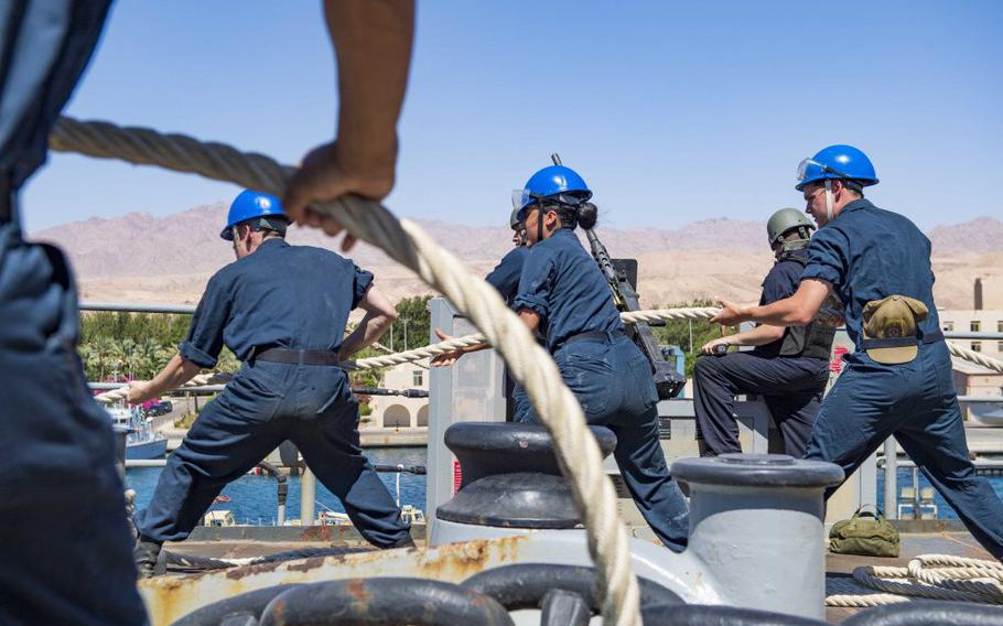 USS Carter Hall sailors haul on a mooring line during a port visit in Aqaba, Jordan. Carter Hall is part of the Norfolk-based Iwo Jima Amphibious Ready Group.