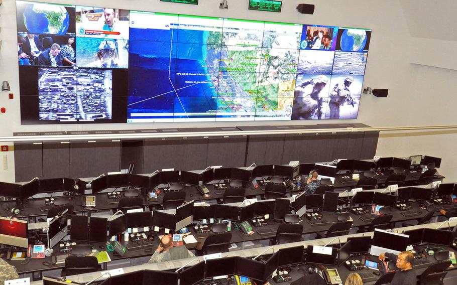 The joint operations center at U.S. Africa Command headquarters in Stuttgart, Germany. Modern command centers feature arrays of screens with live drone imagery, which is beamed to high-ranking leaders thousands of miles away.