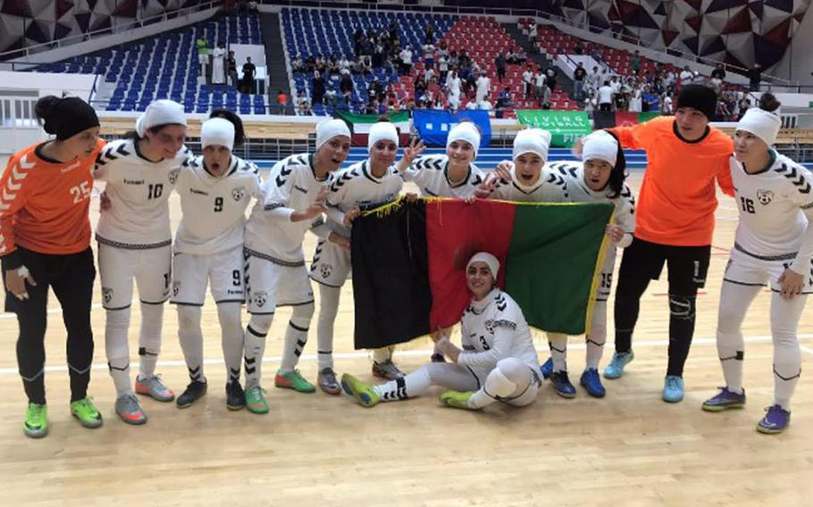 The Afghan national women's soccer team pose for a photo during a tournament in November 2019. Eighty-six players, officials and family members were evacuated from Afghanistan to Australia.