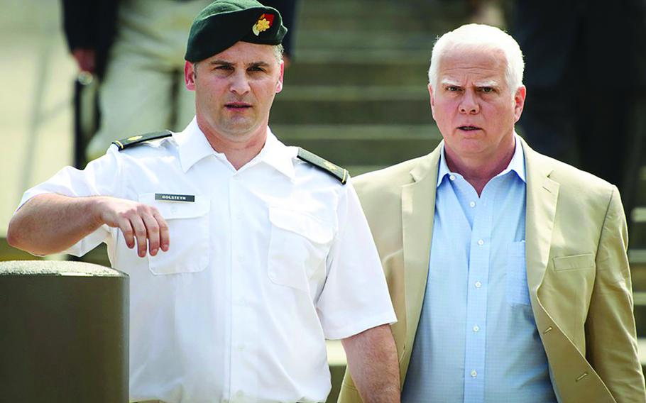 50p na              Maj. Mathew Golsteyn leaves the Fort Bragg courtroom facility with his civilian lawyer, Phillip Stackhouse, right, after a hearing on Thursday, June 27, 2019.