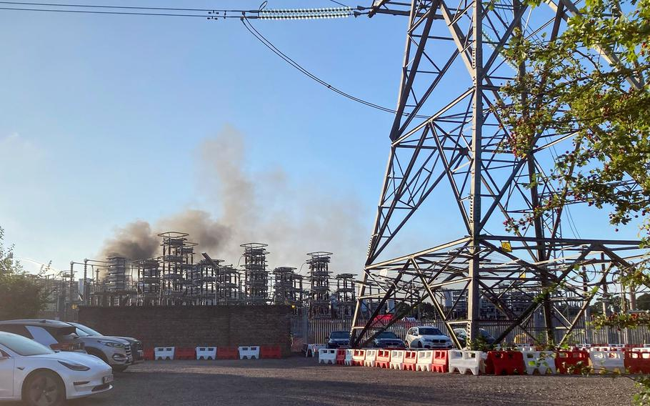 Smoke from a large fire at the National Grid's IFA interconnector site in Sellindge, U.K., is seen on Sept. 15, 2021.