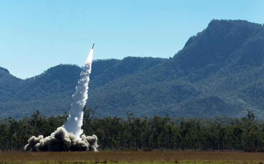 Marines from 3rd Battalion, 12th Marine Regiment, 3rd Marine Division launch an M-270 Guided Multiple Launch Rocket System from Shoalwater Bay Training Area, Australia, July 19, 2021, during exercise Talisman Sabre.