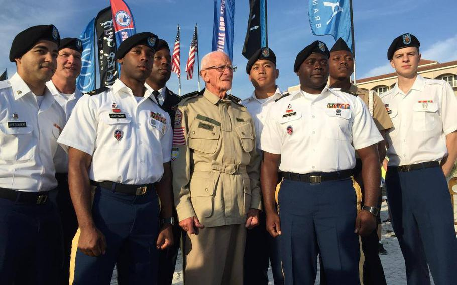 Soldiers of Alpha Company posing with World War II veteran Tom Rice, center,  in 2015.