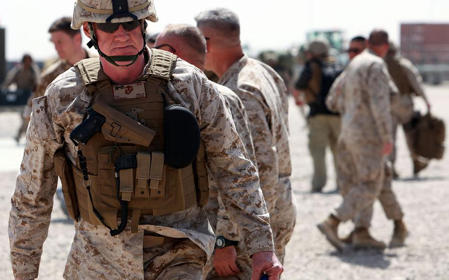 U.S. Marine Maj. Gen. Richard Mills walks off the flight line at Bastion airfield, Camp Leatherneck, Afghanistan, in April 2010. Now a retired lieutenant general, Mills said that many U.S., British, Afghan and allied troops sacrificed greatly in pursuit of a modernized Afghanistan.