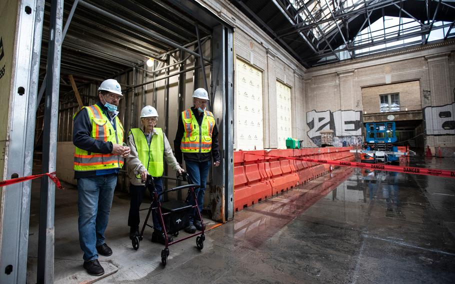 Michigan Central construction manager Richard Bardelli, left, and project manager Gary Marshall, right, guide George England for a tour inside Michigan Central Station in Detroit on Sept. 25, 2021.