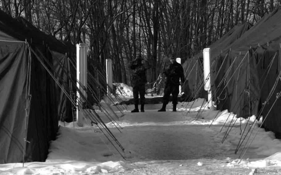 Taszar AB, Hungary, January, 1996: Snow and bitter cold were the companions for soldiers passing through Taszar's tent city on their way to Bosnia.