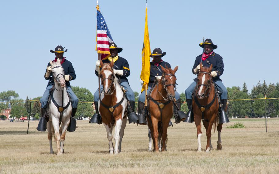 Buffalo Soldier re-enactors ride horses July 24, 2016, during Fort D.A. Russell Days, the annual F.E. Warren Air Force Base, Wyo., open house.