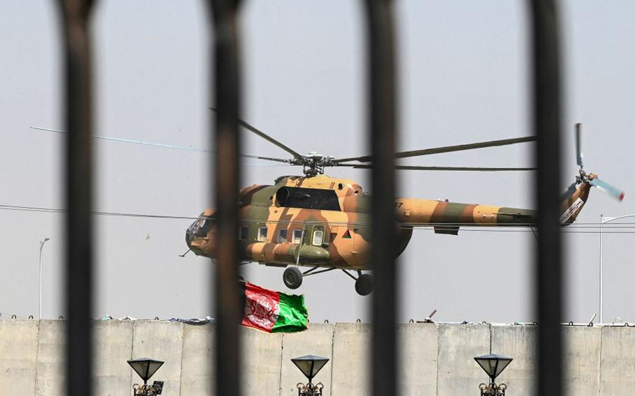 An Afghan Air Force's helicopter rovers near the Afghan Parliament house in Kabul on Aug. 2, 2021.