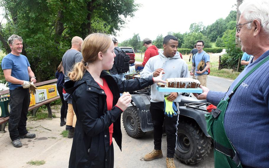 Residents of Rittersdorf, Germany, thank airmen with refreshments for helping them clean up their village in the aftermath of severe flooding last month. More than two dozen airmen from Spangdahlem Air Base and a few from Ramstein Air Base helped villagers clean up debris along the Nims River on July 31, 2021.