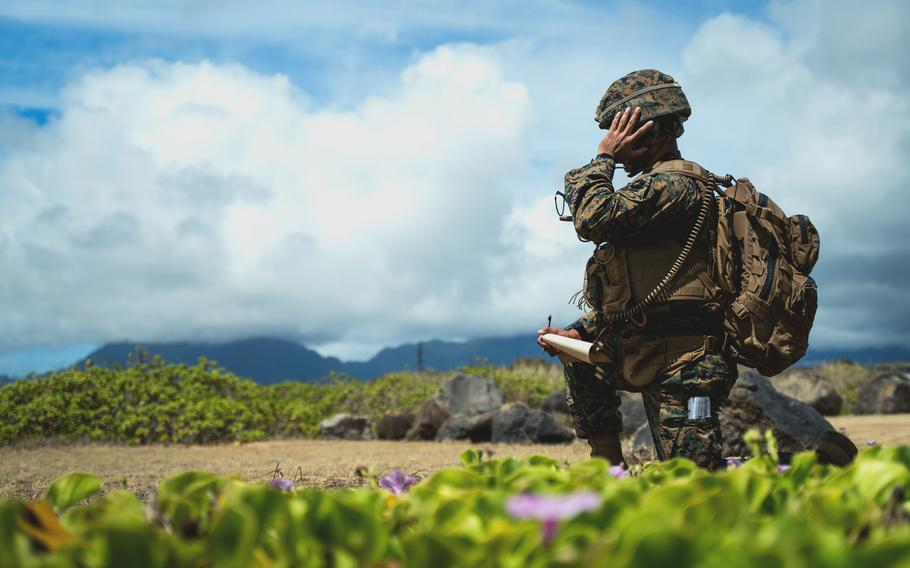 A Marine with 12th Marines, 3rd Marine Division, calls for close air support during Large-Scale Exercise 2021 at Marine Corps Base Hawaii, Aug. 11, 2021.