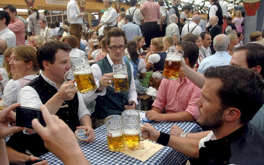 Beer flows in the tents at the Oktoberfest in Munich, Germany. German troops will fly home more than 6,000 gallons of beer and other alcoholic beverages from Afghanistan as they withdraw from the country.