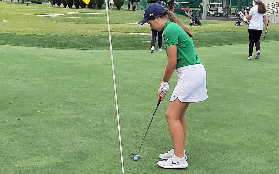 Daegu's Anna Hager lines up a putt during Wednesday's Korea golf matches. Hager won her three-player group 6 and 3 and the Warriors as a team won all four groups.
