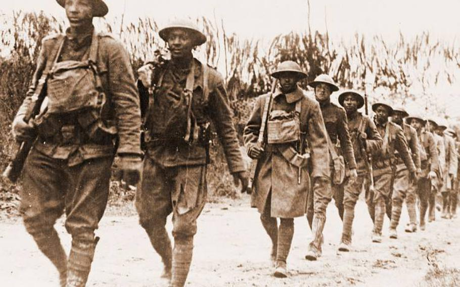 Black soldiers marching in Verdun, France, during World War I.