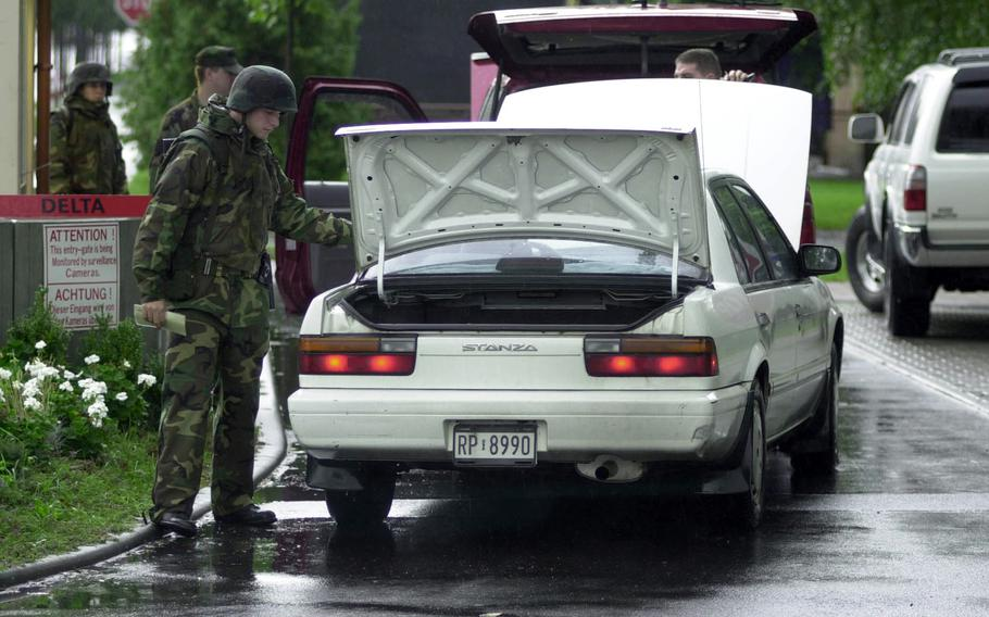 Members of the 469th Security Forces Flight search a vehicle at Rhein-Main Air Base, Germany on Sept. 12, 2001. Every vehicle entering the base was inspected as U.S. forces worldwide remained at Threat Condition Delta, the highest level of alert, after the 9/11 terrorist attacks on New York and Washington, D.C.  Many of the security measures implemented in 2001 are still in place today.