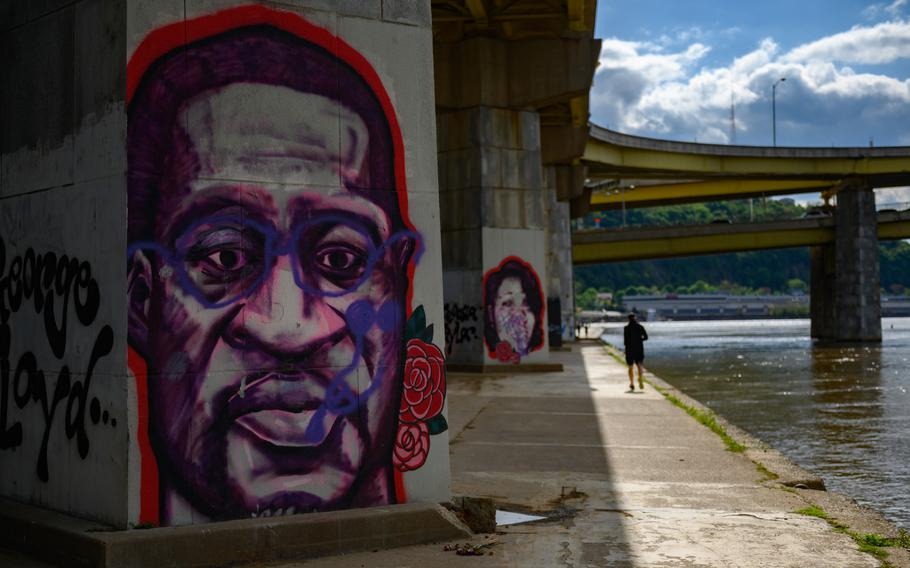 Memorial murals of George Floyd and Breonna Taylor beside the Allegheny River in Pittsburgh.