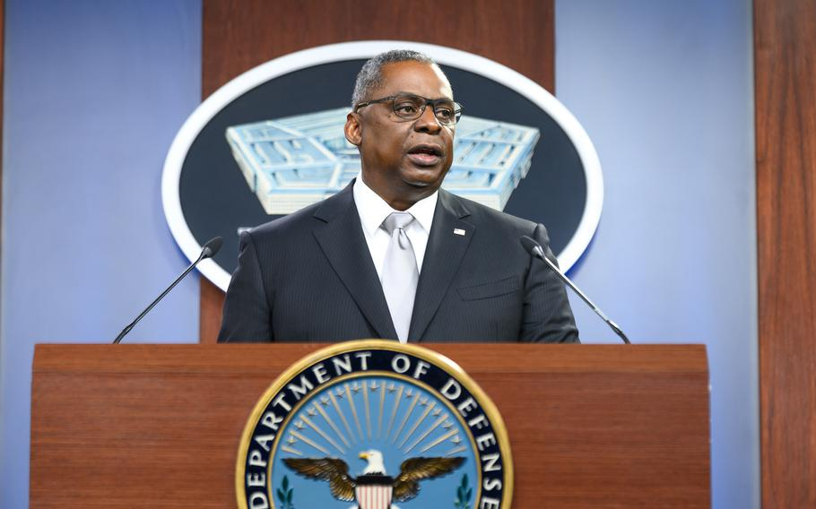 Defense Secretary Lloyd Austin briefs reporters at the Pentagon on Feb. 19, 2021.  Austin said Wednesday that national security could be at risk and Defense Department personnel might not receive their regular paychecks should Congress not vote to suspend the U.S. debt limit.