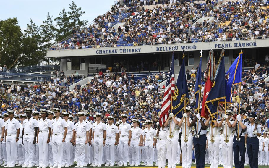 The Brigade of Midshipmen stand at attention during pre-game ceremonies before an NCAA college football game between Navy and Air Force, Saturday, Sept. 11, 2021, in Annapolis, Md.