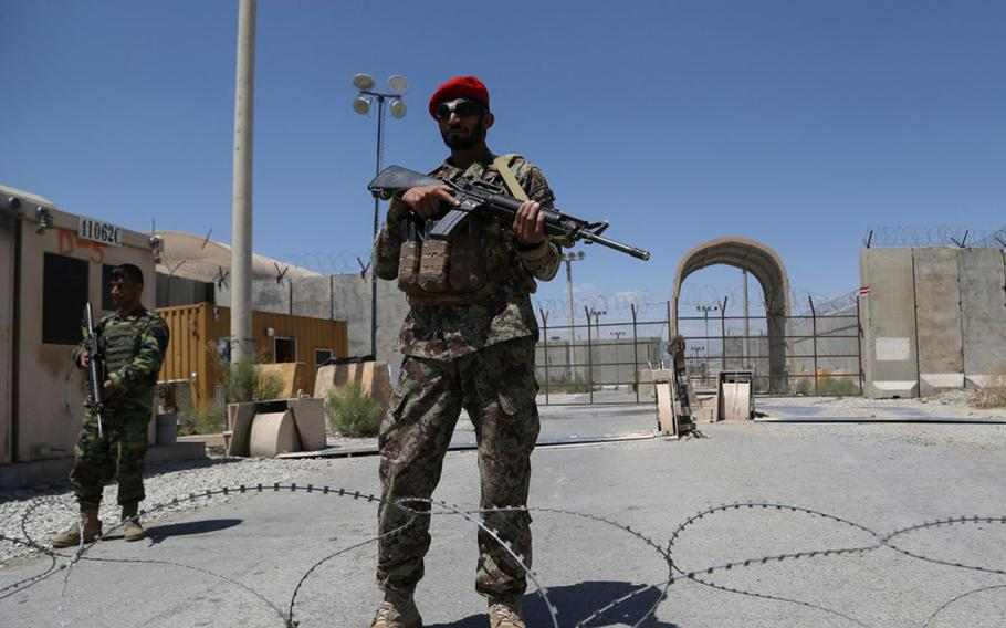 An Afghan National Army soldier stands guard at Bagram Airfield after all U.S. and NATO troops left on July 2, 2021.