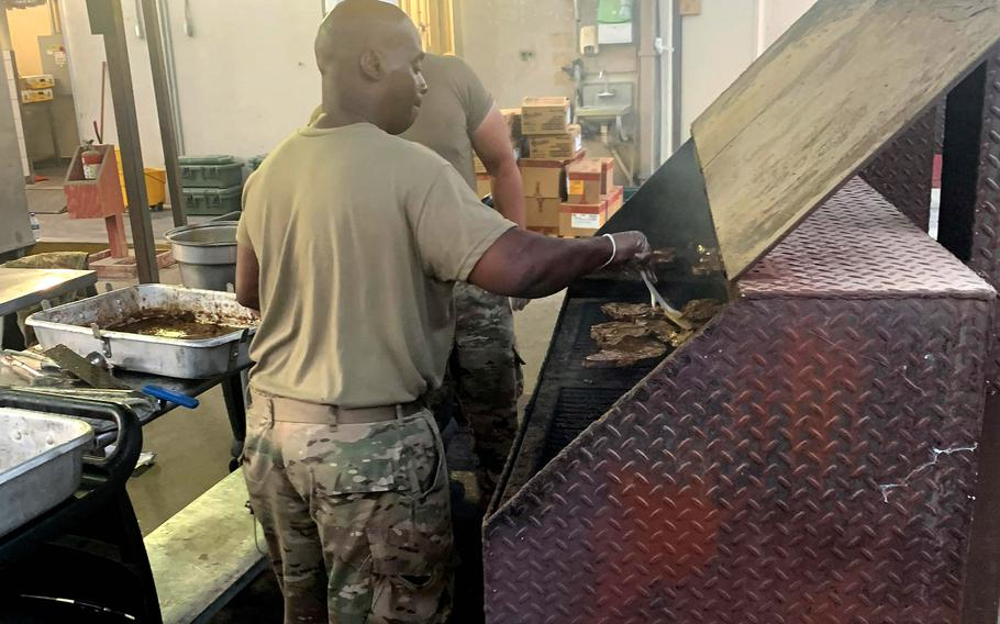 Army Reserve Master Sgt. Lloyd Cossey, deployed to Camp Arifjan, Kuwait, with the Indianapolis-based 310th Sustainment Command (Expeditionary), grills steaks at the North Dining Facility at Bagram Airfield, Afghanistan, during his 29-day assignment there that ended July 2, 2021, as the base closed.