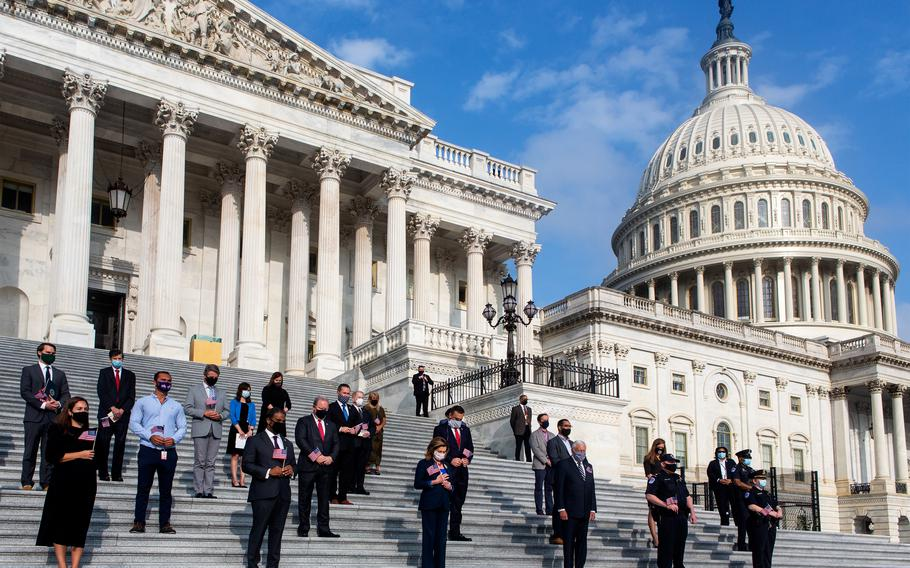 Members of Congress and staff stand for a moment of silence for the 9/11 victims and families on Sept. 11, 2020, at the Capitol in Washington. On Monday, Sept. 13, 2021, members of Congress will mark the 20th anniversary of the attacks.