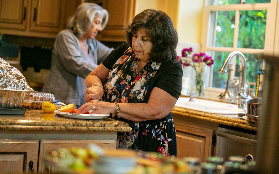 Pamela Taylor, an evacuee of the Caldor fire in South Lake Tahoe, prepares apples and honey for the Jewish New Year in Calabasas, Calif.