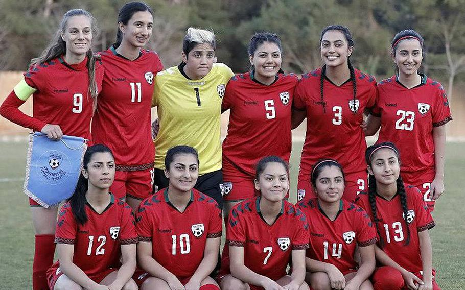 Members of the Afghan women's national soccer team pose in a February 2018 photo. Eighty-six players, officials and family members were evacuated from Afghanistan to Australia.