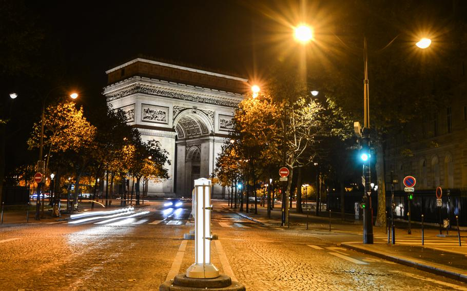 A nocturnal view of the Arc de Triomphe, one of the most famous monuments in Paris.