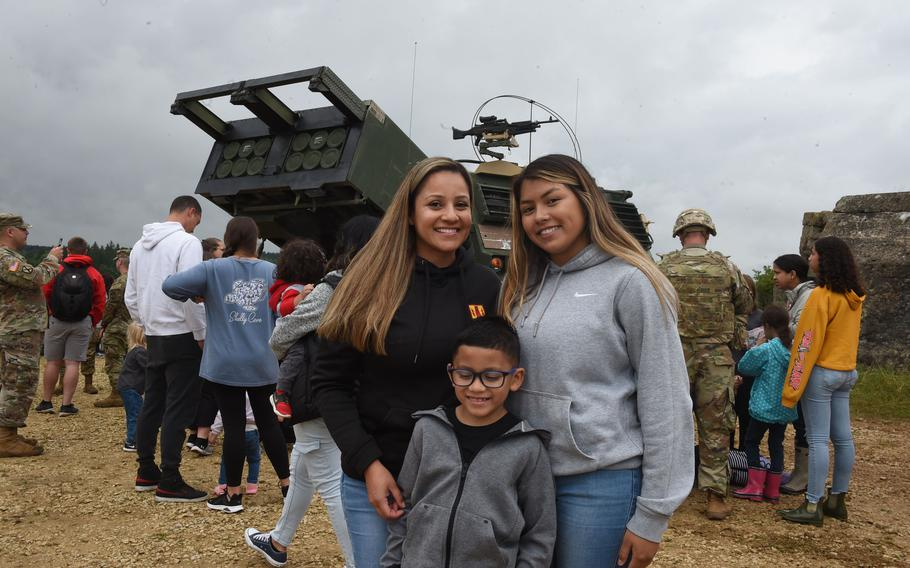 Sgt. Monica Salazar, left, a soldier with the 41st Field Artillery Brigade, poses with her two children, Rafael, center, and Jasmine, right, at Grafenwoehr Training Area on Aug. 5, 2021. The 41st FAB hosted a family day during a live-fire training exercise the unit conducted.