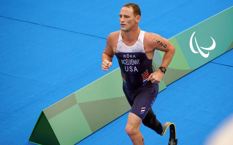 Former Marine captain Eric McElvenny competes in a Paralympic triathlon at Odaiba Marine Park in Tokyo, Saturday, Aug. 28, 2021. He lost his right leg to an improvised explosive device in 2011 while serving with 2nd Battalion, 4th Marine Regiment in Helmand Province, Afghanistan.