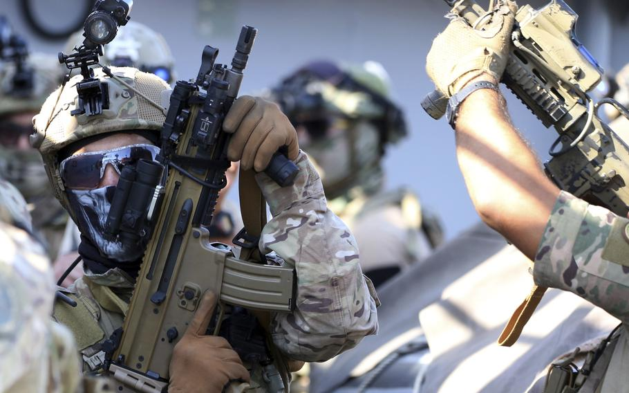 Special forces operators hold their weapons during a joint U.S.-Cyprus military drill at Limassol port on Friday, Sept. 10, 2021.