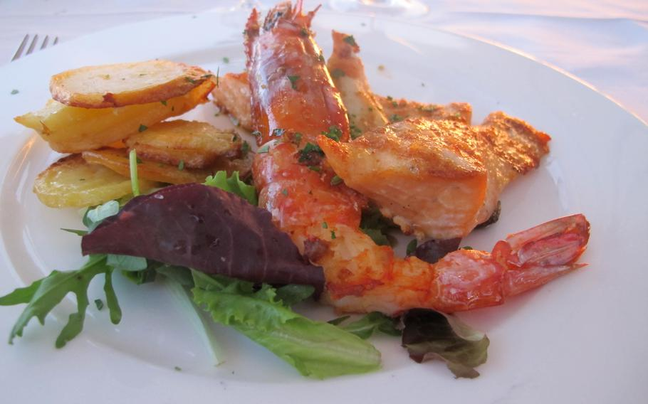 A second course of grilled fish and shellfish at Hotel Catullo in Sirmione, Italy, where diners can order a la carte or, if they are hotel guests, can choose the more economical and equally set menu delicious.