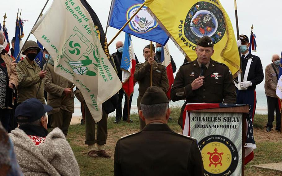 Lt. Gen. John Kolasheski, V Corps commander, speaks at a ceremony June 4, 2021 at Omaha Beach in Normandy, France. The event honored retired Army medic Charles Shay and the service of World War II Native Americans. Shay, standing at the left, facing Kolasheski, landed on the beach during the 1944 D-Day invasion and was later awarded the Silver Star.