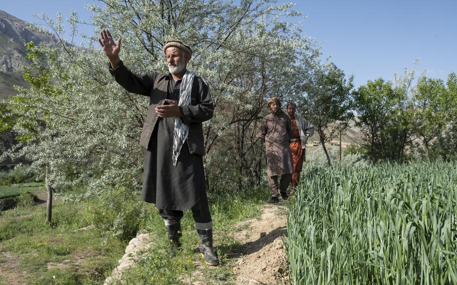 Mohammad Alim Faqiri, a farmer and former Mujahedeen fighter, points out the mountains in Panjshir province, Afghanistan, on April 27, 2021, where he said he once fought Soviet troops.   Phillip Walter Wellman/Stars and Stripes