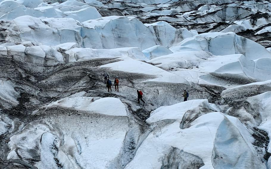 Recovery team members traverse Colony Glacier, Alaska, June 2019. The recovery team was searching for remains from a C-124 Globemaster II that crashed into Gannett Mountain, Alaska, on Nov. 22, 1952, while flying from McChord Air Force Base, Washington, to Elmendorf Air Force Base, Alaska, resulting in the loss of 52 service members.