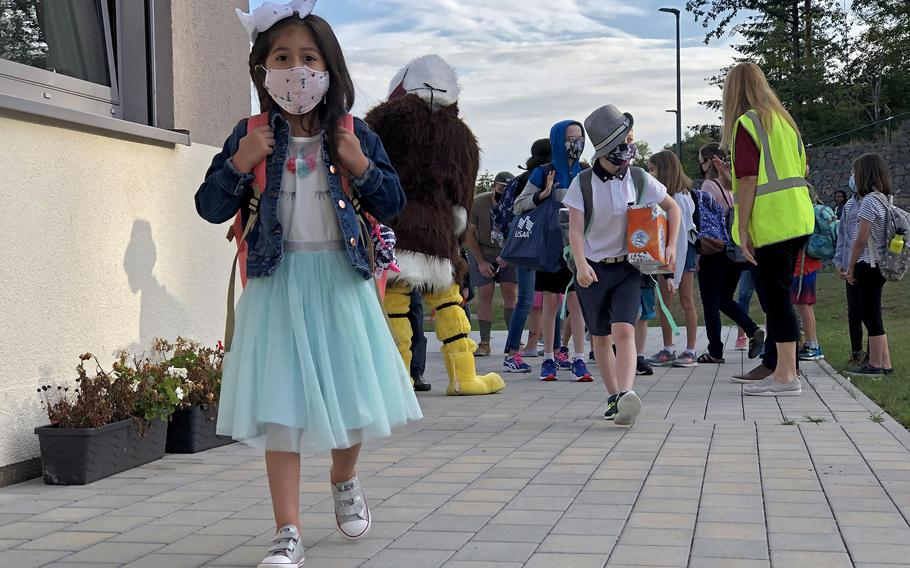 Student walks to class on the first day of school in August 2020 at Vogelweh Elementary School, Germany. Face masks will be required indoors for students and teachers at Defense Department schools when the new school year starts, including for those who are already vaccinated against the coronavirus, school and military officials said.
