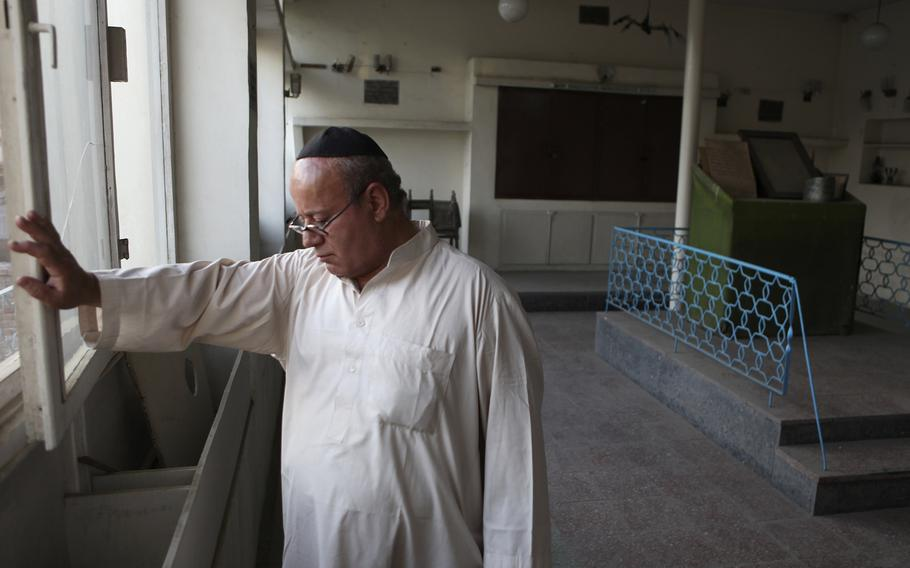 Zebulon Simentov, the last known Jew living in Afghanistan, closes the window to the synagogue he cares for in his Kabul home on Aug. 29, 2009.