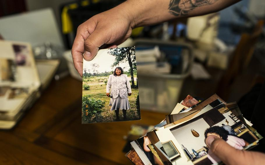 Shane Steindorf holds a photograph of his mother who died from covid-19 on May 5.