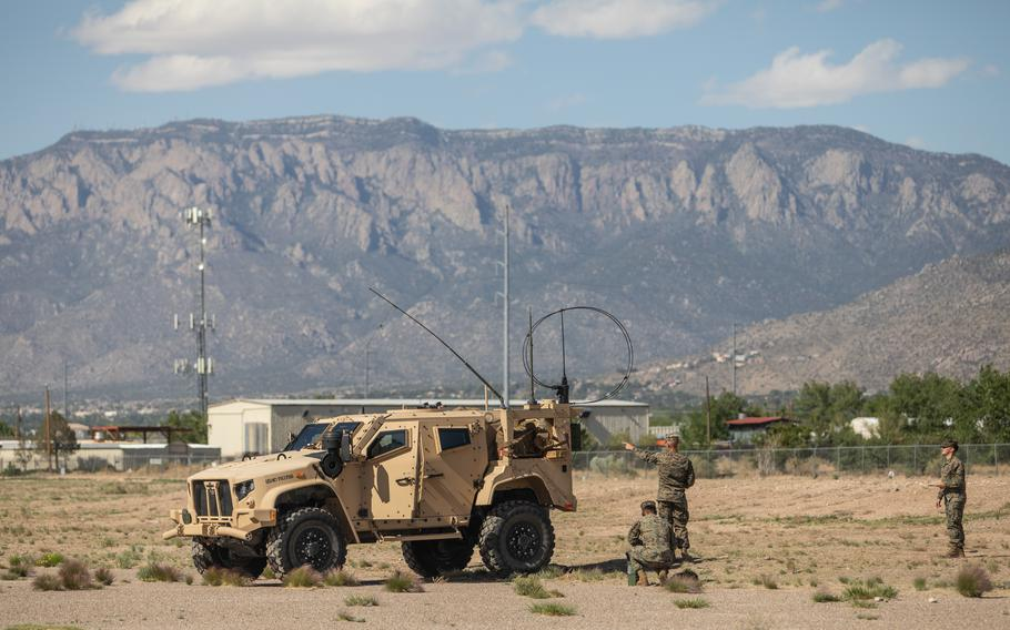 Marines set up a high frequency radio on Kirtland Air Force Base, N.M., May 11, 2021. Marines in tactical vehicles and trucks drove from Camp Lejeune, N.C., to Twentynine Palms, Calif., in one of the longest convoys in Marine Corps history.