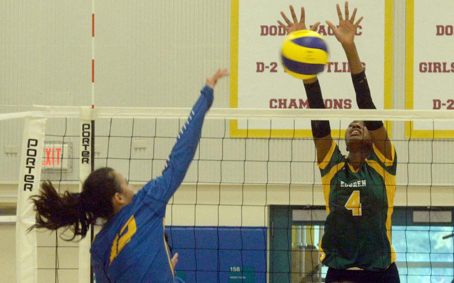 Robert D. Edgren's Elizabeth Johnson goes up to block a shot by Yokota's Elena Haas during Friday's girls volleyball match. The Eagles won in straight sets.