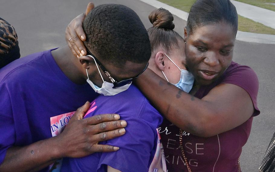 Ricky Franklin and his wife, Caylenn Franklin, center, are comforted by Anglea Jackson on Aug. 6 in West Memphis, Ark. The Franklins' 11-year-old daughter, Jordyn, died of COVID.