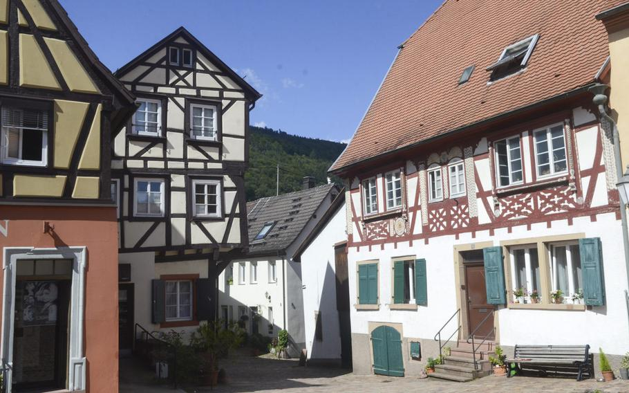 Traditional German half-timbered homes and business in the center of the medieval Baden-Wuerttemburg town of Neckargemuend, just outside Heidelberg. The town is situated along a gentle stretch of the Neckar River in the Odenwald forest.