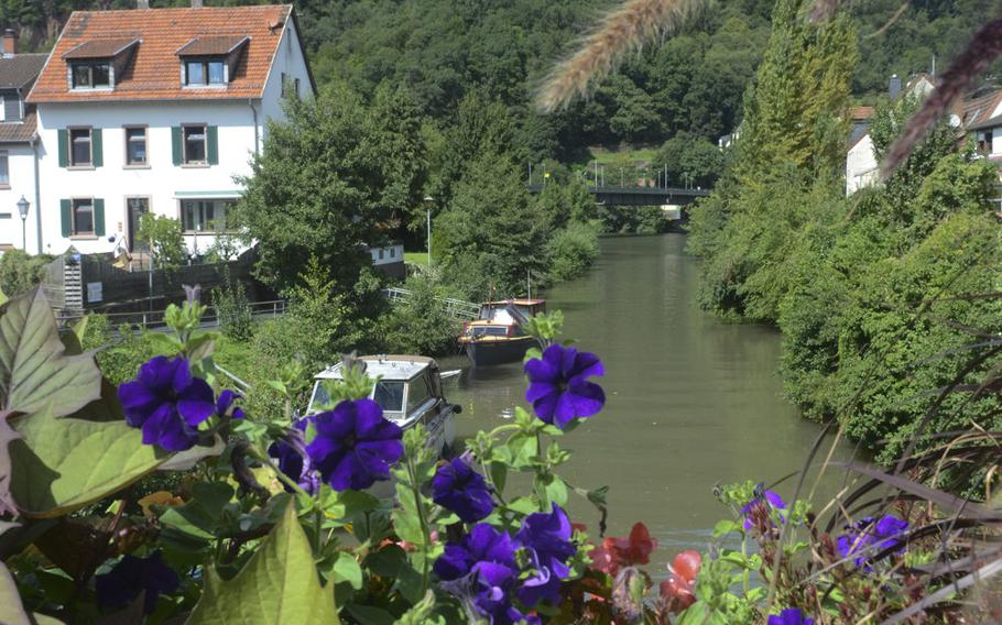 A bridge over the tranquil Elsanz River is lined with flowers in the picturesque town of Neckargemuend, just outside Heidelberg.