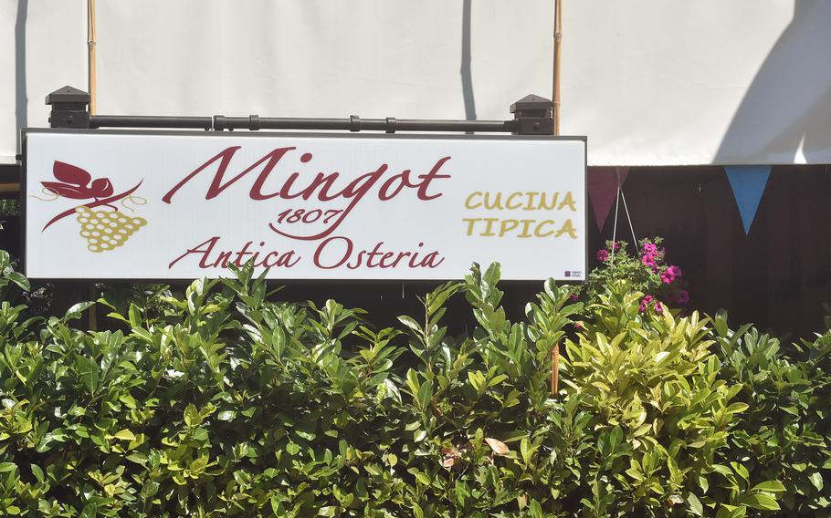 If you don't know where it is, it's fairly easy to miss Antica Osteria Mingot, which is located among a maze of smaller streets northwest of Pordenone, Italy. This sign, which fronts the patio dining area, is the most visible marker.