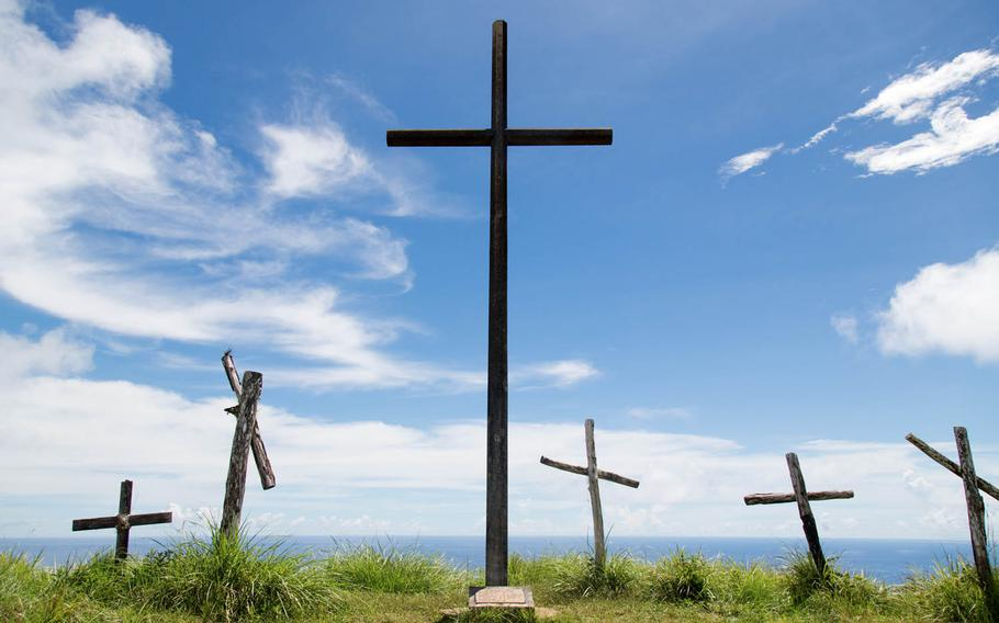 Crosses are seen Aug. 16 at the summit of Mount Jumullong Manglo, Guam, en route to the peak of Mount Lamlam.