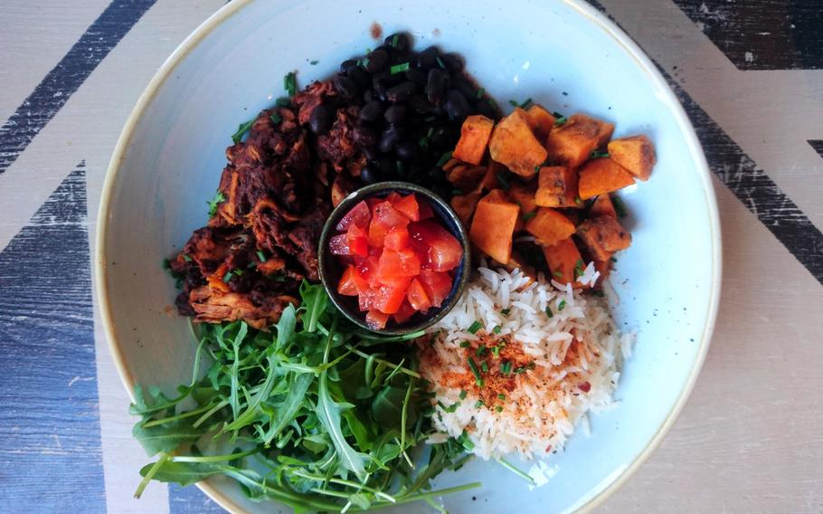 A nonvegetarian item on the menu of Edmundo Lounge is the Mexican Superbowl with Moroccan chicken, black beans, roasted sweet potato, butternut squash, balsamic rice, rocket, and tomato with chili salsa . The restaurant often tests new dishes on a specials menu.