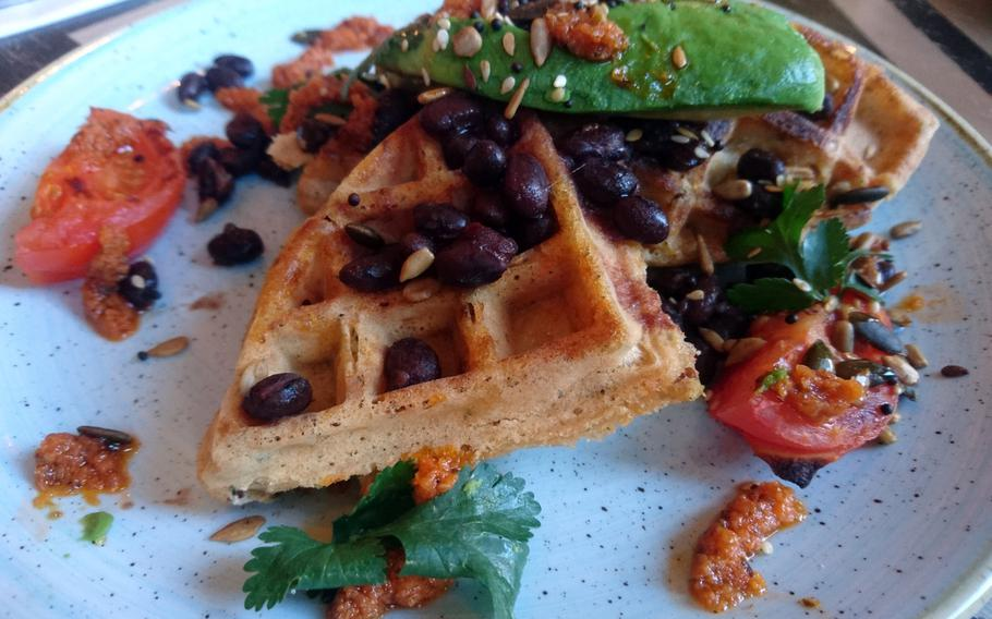 An order of sweet potato waffles with black beans, avocado, lime and coriander from the Edmundo Lounge, Bury St. Edmunds, England. The restaurant offers separate regular, gluten-free and vegan menus.